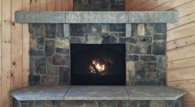 The Acadia Fireplace features Ashlar Veneer Stone