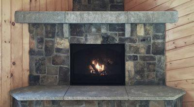 The Acadia Fireplace features Ashlar Veneer Stone